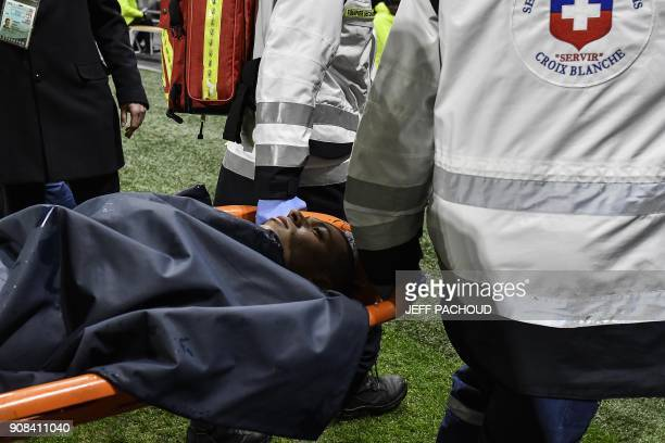 TOPSHOT Paris SaintGermain's French forward Kylian Mbappe is carried off the pitch on a stretcher after being injured during the French L1 football...
