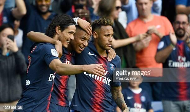 TOPSHOT Paris SaintGermain's French forward Kylian Mbappe is congratulated by Paris SaintGermain's Brazilian forward Neymar and Paris SaintGermain's...