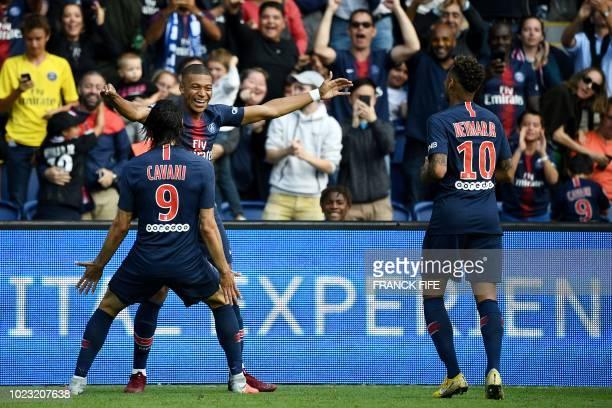 Paris SaintGermain's French forward Kylian Mbappe is congratulated by Paris SaintGermain's Brazilian forward Neymar and Paris SaintGermain's...