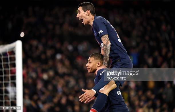 TOPSHOT Paris SaintGermain's French forward Kylian Mbappe is congratulated by Paris SaintGermain's Argentine midfielder Angel Di Maria after scoring...