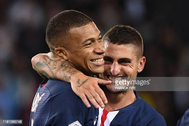 TOPSHOT Paris SaintGermain's French forward Kylian Mbappe is congratulated by Paris SaintGermain's Italian midfielder Marco Verratti after scoring a...