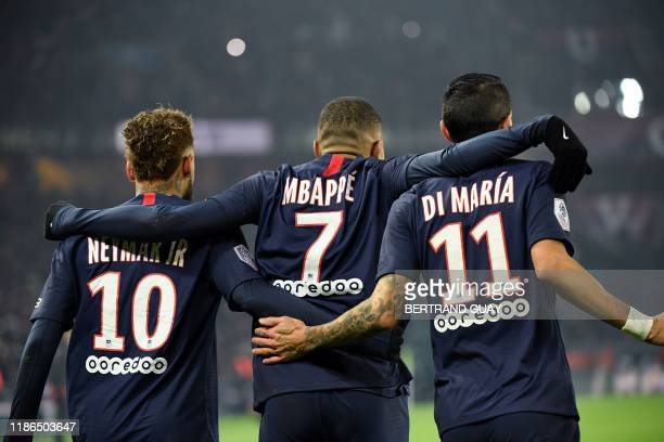 TOPSHOT Paris SaintGermain's French forward Kylian Mbappe is congratulated by Paris SaintGermain's Brazilian forward Neymar and Paris SaintGermain's...