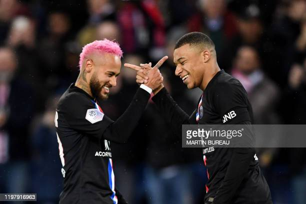 TOPSHOT Paris SaintGermain's French forward Kylian Mbappe is congratulated by Paris SaintGermain's Brazilian forward Neymar after scoring a goal...