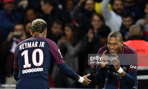 Paris SaintGermain's French forward Kylian Mbappe is congratuled by Paris SaintGermain's Brazilian forward Neymar after scoring a goal during the...