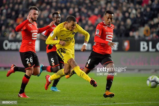 Paris SaintGermain's French forward Kylian Mbappe kicks the ball during the French L1 football match between Rennes and Paris Saint Germain on...
