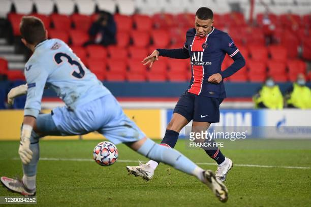 Paris Saint-Germain's French forward Kylian Mbappe kiskc to score his second goal during the UEFA Champions League group H football match between...