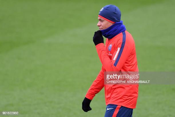 Paris SaintGermain's French forward Kylian Mbappe looks on during a training session of French L1 football club Paris SaintGermain in...