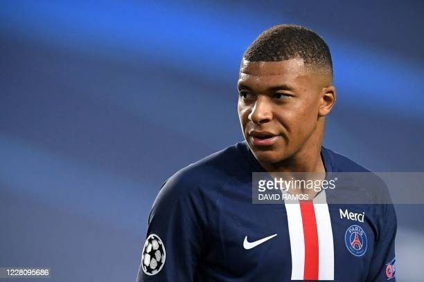 Paris Saint-Germain's French forward Kylian Mbappe looks on during the UEFA Champions League semi-final football match between Leipzig and Paris...