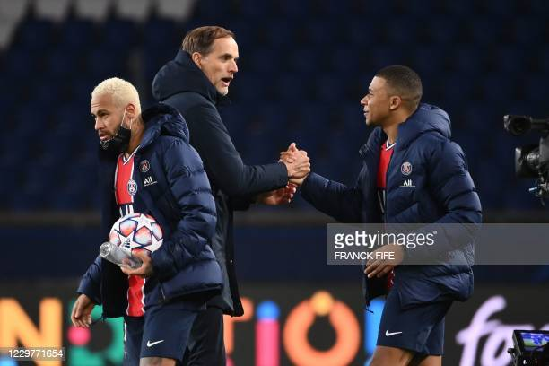 Paris Saint-Germain's French forward Kylian Mbappe , Paris Saint-Germain's German coach Thomas Tuchel and Paris Saint-Germain's Brazilian forward...