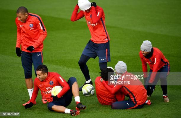 Paris SaintGermain's French forward Kylian MBappe Paris SaintGermain's Brazilian defender Marquinhos and teammates during a training session in...
