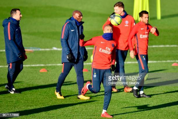 Paris SaintGermain's French forward Kylian Mbappe plays the ball during a training session of French L1 football club Paris SaintGermain in...