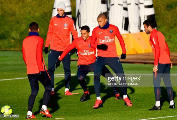 Paris SaintGermain's French forward Kylian Mbappe plays the ball with teammates during a training session of French L1 football club Paris...