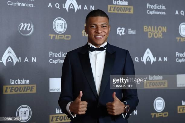 TOPSHOT Paris SaintGermain's French forward Kylian Mbappe poses upon arrival at the 2018 Ballon d'Or award ceremony at the Grand Palais in Paris on...
