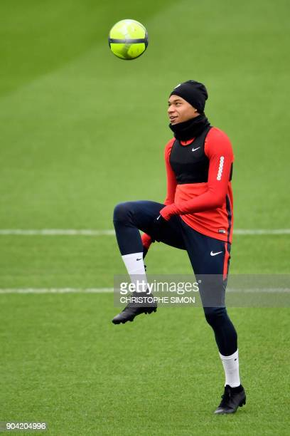 Paris SaintGermain's French forward Kylian Mbappe practices during a training session on January 12 2018 at the Camp des Loges in SaintGermainenLaye...