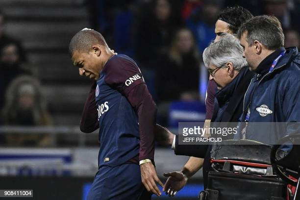 TOPSHOT Paris SaintGermain's French forward Kylian Mbappe reacts after being injured during the French L1 football match between Olympique Lyonnais...