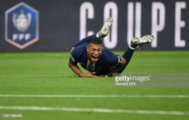 TOPSHOT Paris SaintGermain's French forward Kylian Mbappe reacts as he is fouled during the French Cup final football match between Paris...