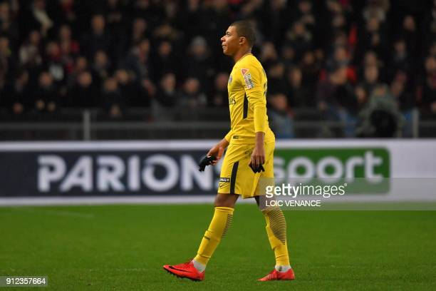 Paris SaintGermain's French forward Kylian Mbappe reacts as he leaves the football pitch after receiving a red card during the French League Cup...