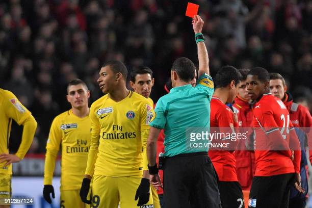 Paris SaintGermain's French forward Kylian Mbappe reacts as the referee gives him a red card during the French League Cup football semifinal match...