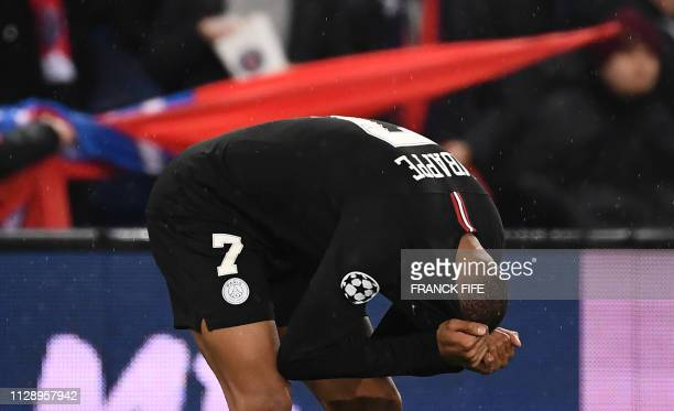 TOPSHOT Paris SaintGermain's French forward Kylian Mbappe reacts at the end of the UEFA Champions League round of 16 secondleg football match between...