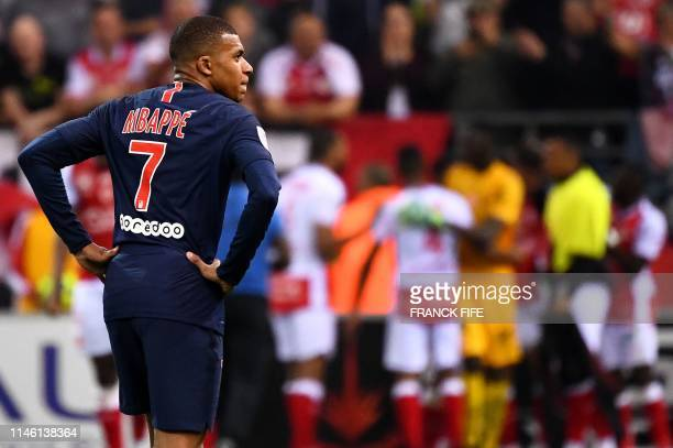 Paris SaintGermain's French forward Kylian Mbappe reacts at the end of the French L1 football match between Stade de Reims and Paris SaintGermain at...