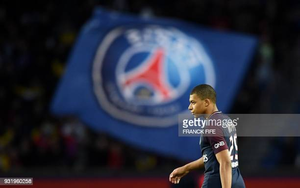 Paris SaintGermain's French forward Kylian MBappe reacts at the end of the French Ligue 1 football match between Paris SaintGermain and Angers at the...