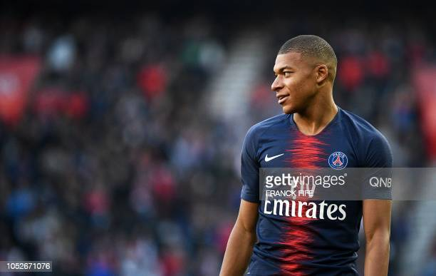 Paris SaintGermain's French forward Kylian MBappe reacts during the French Ligue 1 football match between Paris SaintGermain and Amiens at the Parc...
