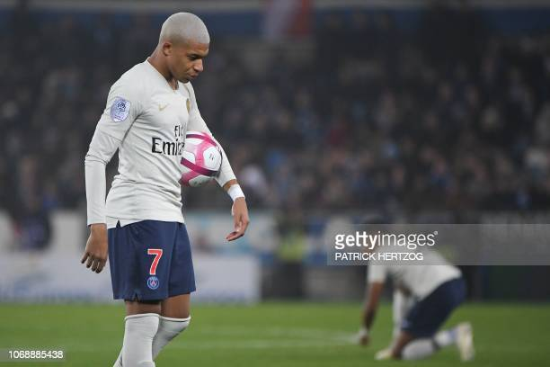 Paris SaintGermain's French forward Kylian Mbappe reacts during the French L1 football match between Strasbourg and Paris SaintGermain at the Stade...
