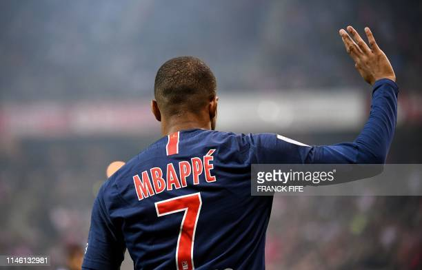 TOPSHOT Paris SaintGermain's French forward Kylian MBappe reacts during the French L1 football match between Reims and Paris SaintGermain at the...