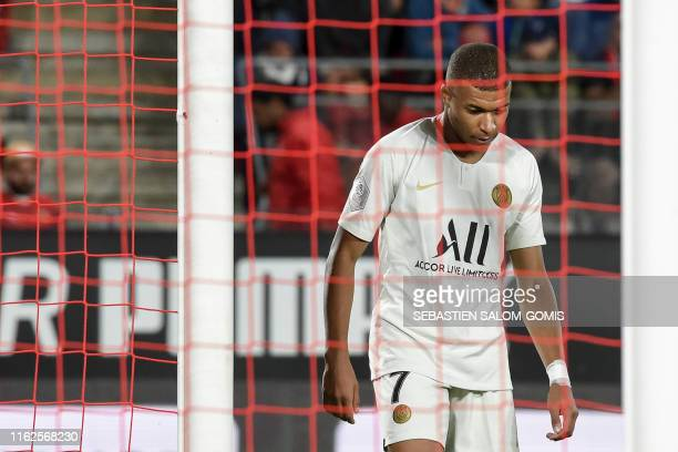 TOPSHOT Paris SaintGermain's French forward Kylian Mbappe reacts during the French L1 football match between Rennes and Paris SaintGermain on August...