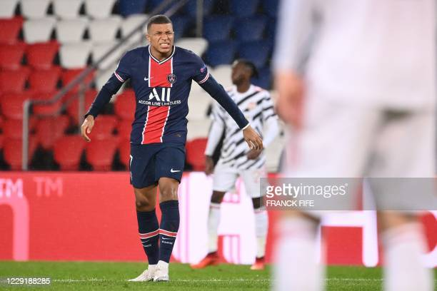 Paris SaintGermain's French forward Kylian Mbappe reacts during the UEFA Champions League Group H firstleg football match between Paris SaintGermain...