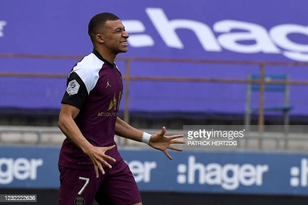 Paris Saint-Germain's French forward Kylian Mbappe reacts during the French L1 football match between Strasbourg and Paris-Saint Germain at The...