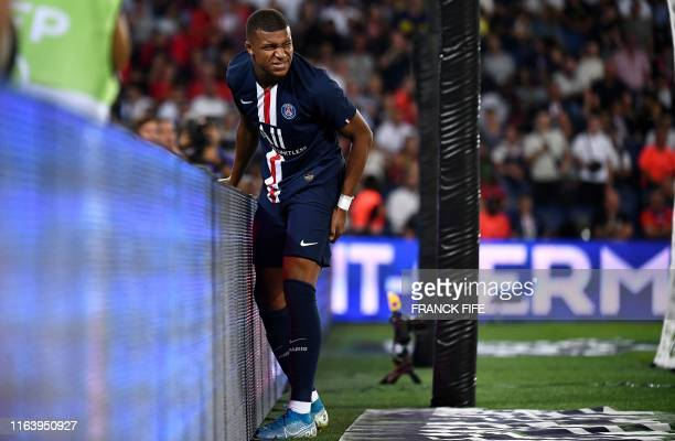 Paris SaintGermain's French forward Kylian Mbappe reacts following an injury during the French L1 football match between Paris SaintGermain and...