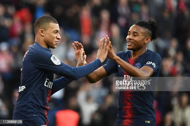 Paris SaintGermain's French forward Kylian Mbappe reacts with Paris SaintGermain's French midfielder Christopher Nkunku after his goal was refused...