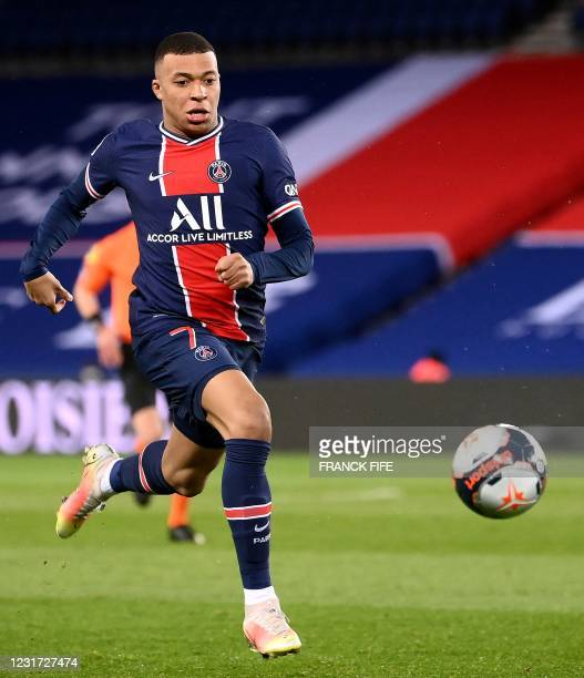 Paris Saint-Germain's French forward Kylian Mbappe runs after the ball during the French L1 football match between PSG and Nantes at the Parc des...