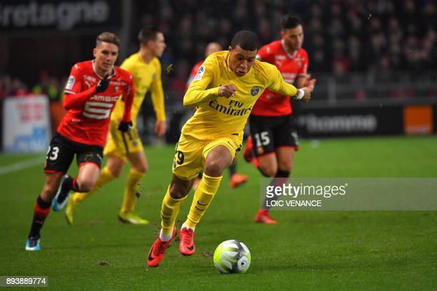Paris SaintGermain's French forward Kylian Mbappe runs with the ball during the French L1 football match between Rennes and Paris Saint Germain on...