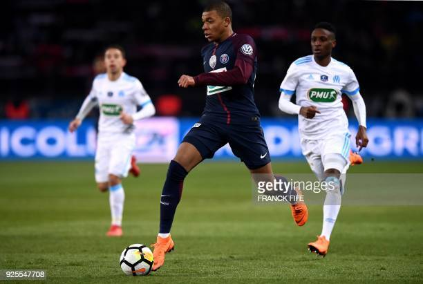 Paris SaintGermain's French forward Kylian Mbappe runs with the ball during the French Cup quarterfinal football match between Paris SaintGermain and...