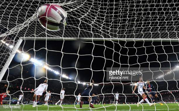 TOPSHOT Paris SaintGermain's French forward Kylian MBappe scores a goal during the French L1 football match between Paris SaintGermain and Olympique...