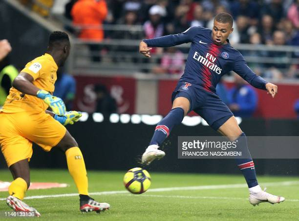 Paris SaintGermain's French forward Kylian MBappe scores a goal during the French Ligue 1 football match between Reims and Paris SaintGermain at the...
