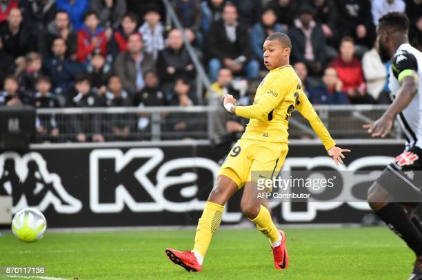 Paris SaintGermain's French forward Kylian Mbappe scores a goal during the French L1 football match between Angers and Paris SaintGermain on November...
