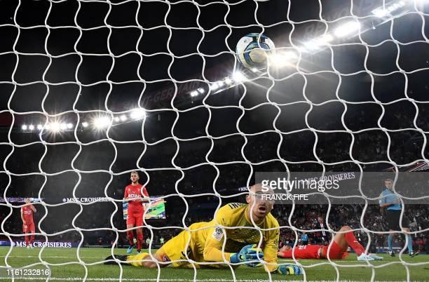 Paris Saint-Germain's French forward Kylian Mbappe scores a goal against Nimes' French goalkeeper Paul Bernardoni during the French L1 football match...