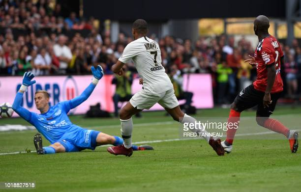 Paris Saint-Germain's French forward Kylian Mbappe scores their second goal to Guingamp's Swedish goalkeeper Karl-Johan Johnsson during the French L1...