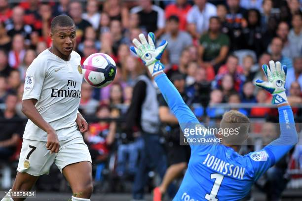 Paris Saint-Germain's French forward Kylian Mbappe scores to Guingamp's Swedish goalkeeper Karl-Johan Johnsson during the French L1 football match...