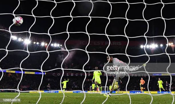Paris SaintGermain's French forward Kylian Mbappe shoots and scores a goal past Lille's French goalkeeper Mike Maignan during the French L1 football...