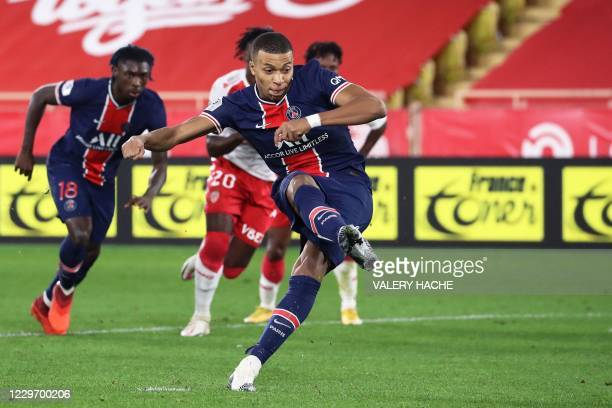 Paris Saint-Germain's French forward Kylian Mbappe shoots and scores a penalty kick during the French L1 football match between Monaco and Paris...