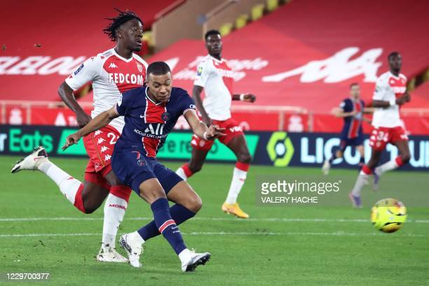 Paris Saint-Germain's French forward Kylian Mbappe shoots and scores a goal during the French L1 football match between Monaco and Paris...