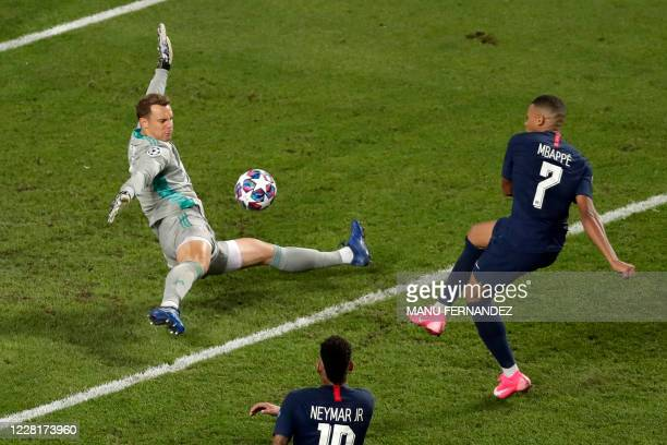 Paris SaintGermain's French forward Kylian Mbappe shoots on goal against Bayern Munich's German goalkeeper Manuel Neuer despite the referee signaling...