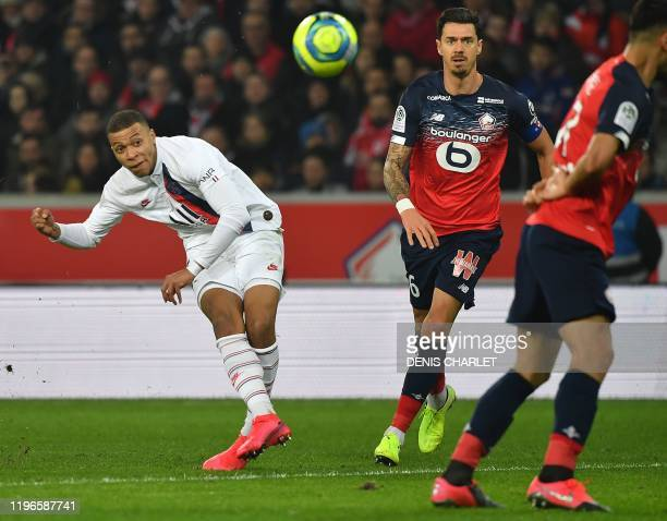 Paris SaintGermain's French forward Kylian Mbappe shoots past Lille's Portuguese defender Jose Fonte during the French L1 football match between...