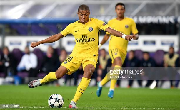 Paris SaintGermain's French forward Kylian Mbappe shots in front Paris SaintGermain's Brazilian forward Neymar during the UEFA Champions League Group...