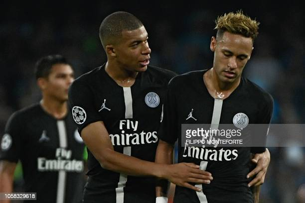 TOPSHOT Paris SaintGermain's French forward Kylian Mbappe speaks to Paris SaintGermain's Brazilian forward Neymar during the European Champions...