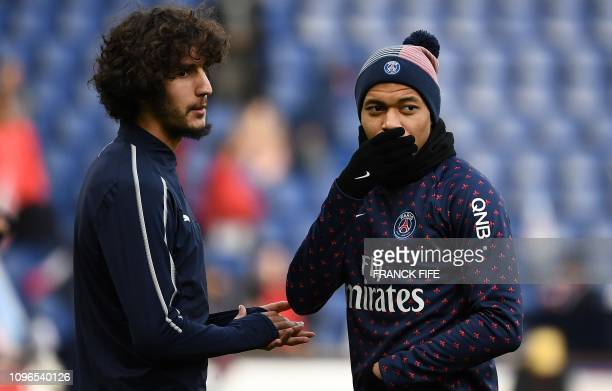 Paris SaintGermain's French forward Kylian MBappe speaks with Bordeaux' midlfielder Yacine Adli ahead of the French L1 football match between Paris...